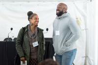 Leah Penniman, codirector and program manager of Soul Fire Farm and author of&nbsp;<em>Farming While Black</em>, speaks with attendee Damien Butts at the 2018 Montgomery Place Salon on Agriculture. Photo by Karl Rabe.