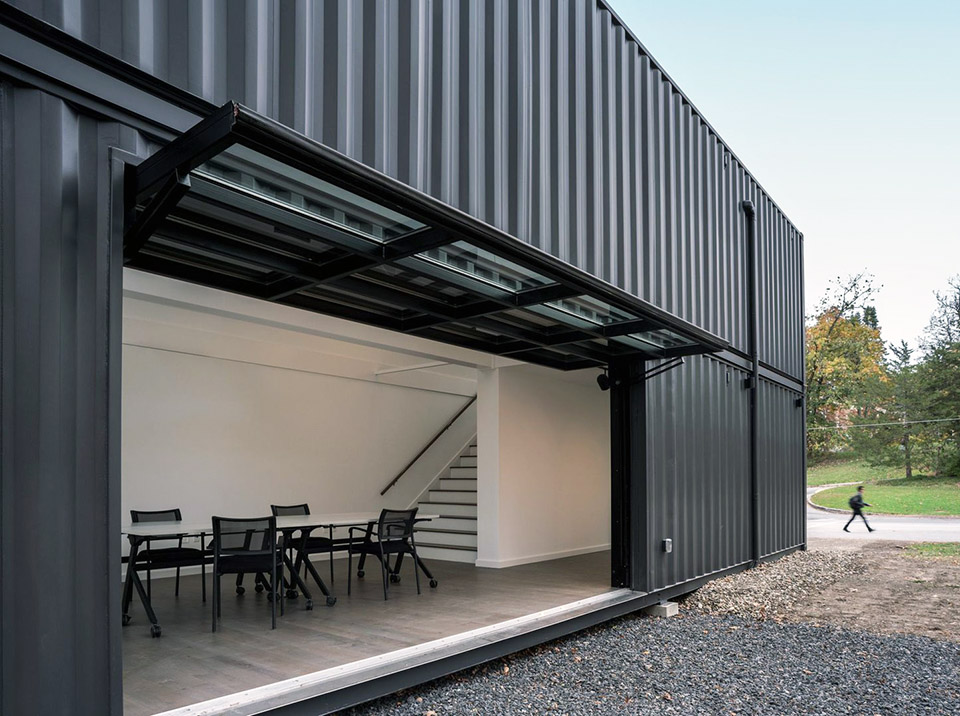 New Annandale House, with garage door open to the outside. Photo: (c) MB Architecture.