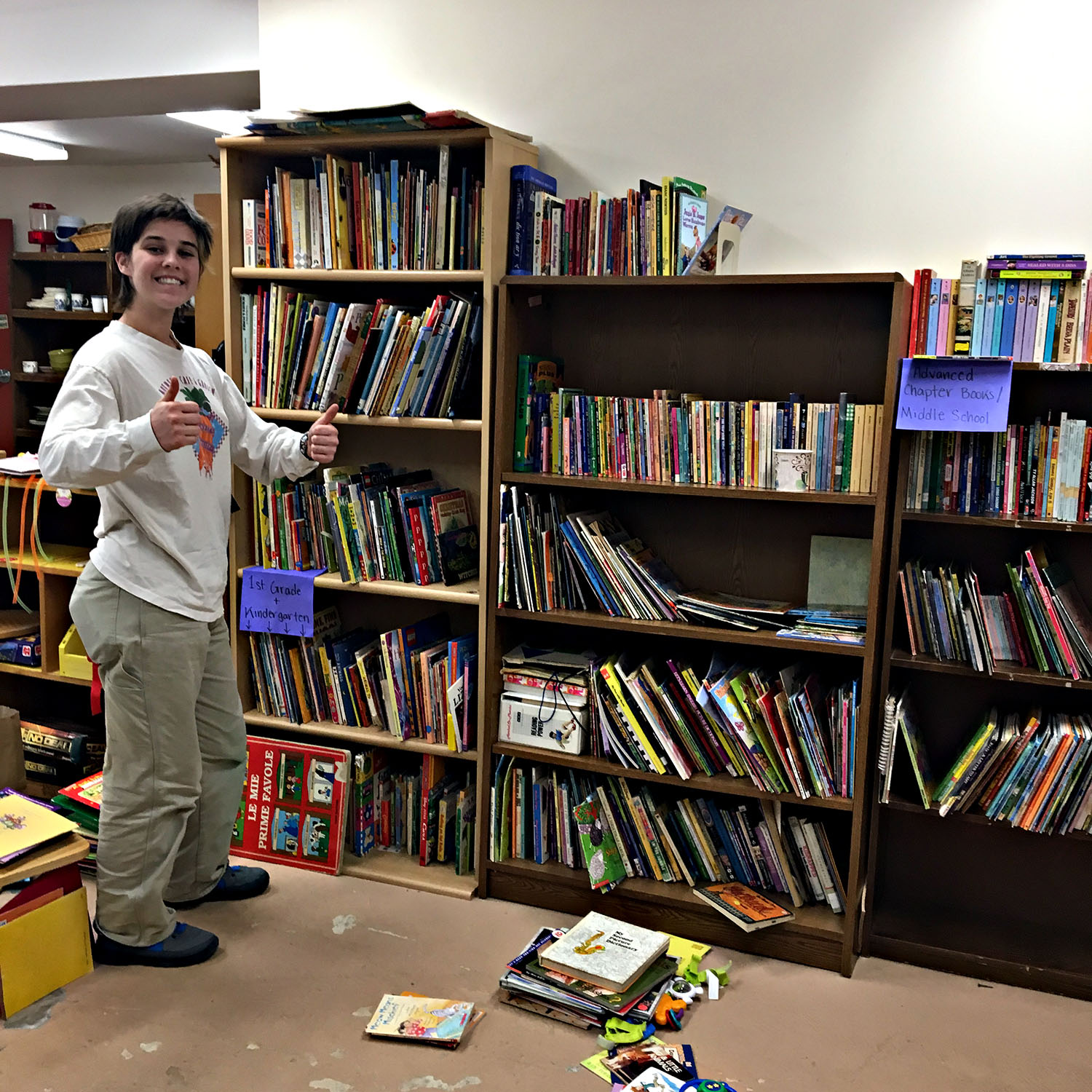 A Bard student volunteer organizes the books in the community closet at the Red Hook Community Center. January 21, 2019.