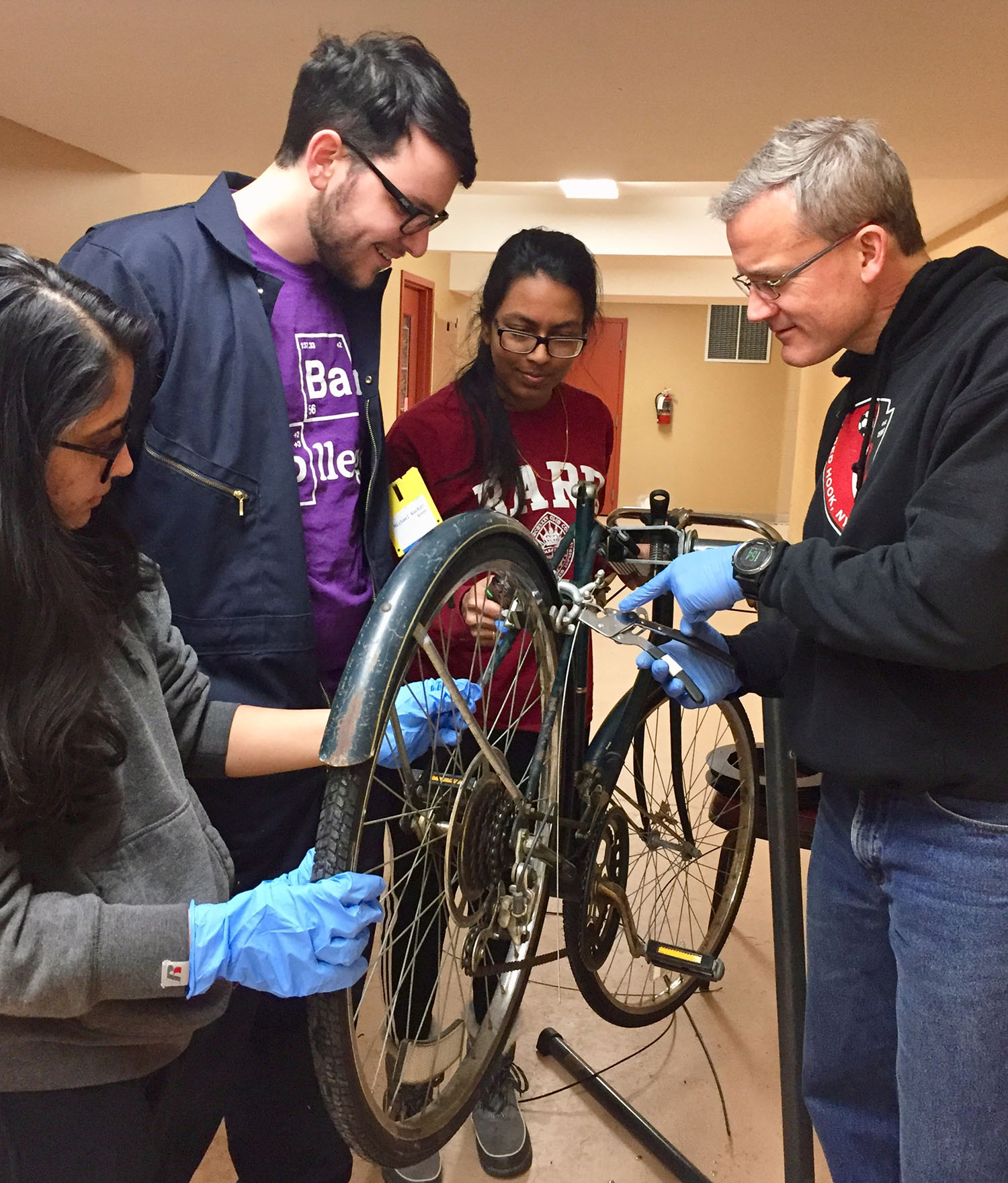 At the Repair Cafe in Red Hook, Bard students and local volunteers fix bicycles.