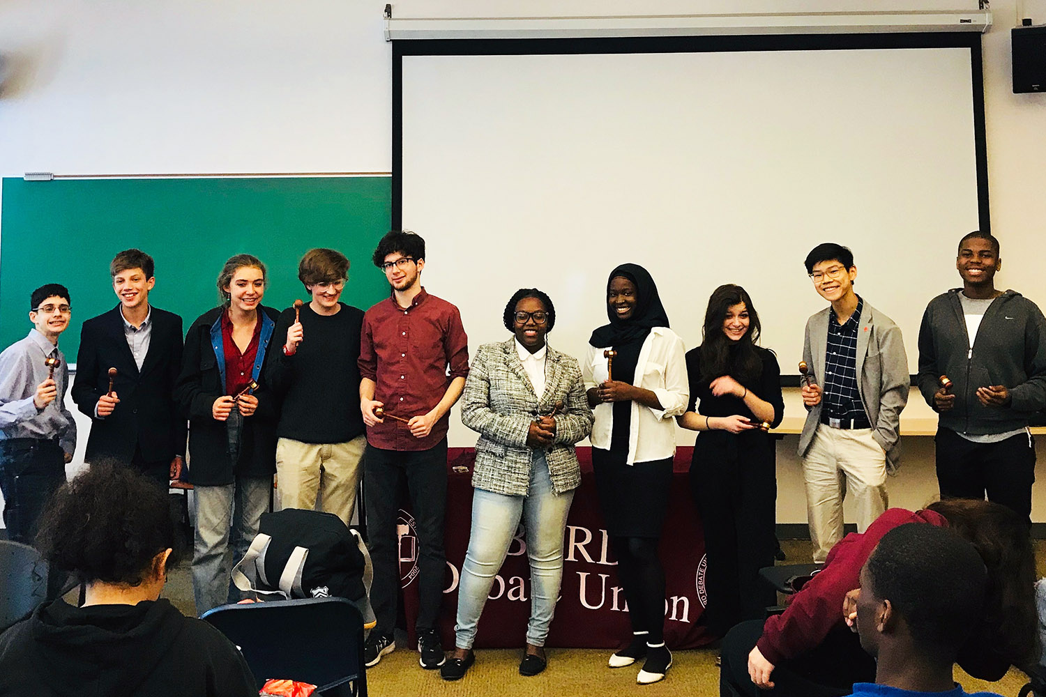 The top 10 speakers at the Early College Debate Tournament are recognized at the closing awards ceremony.