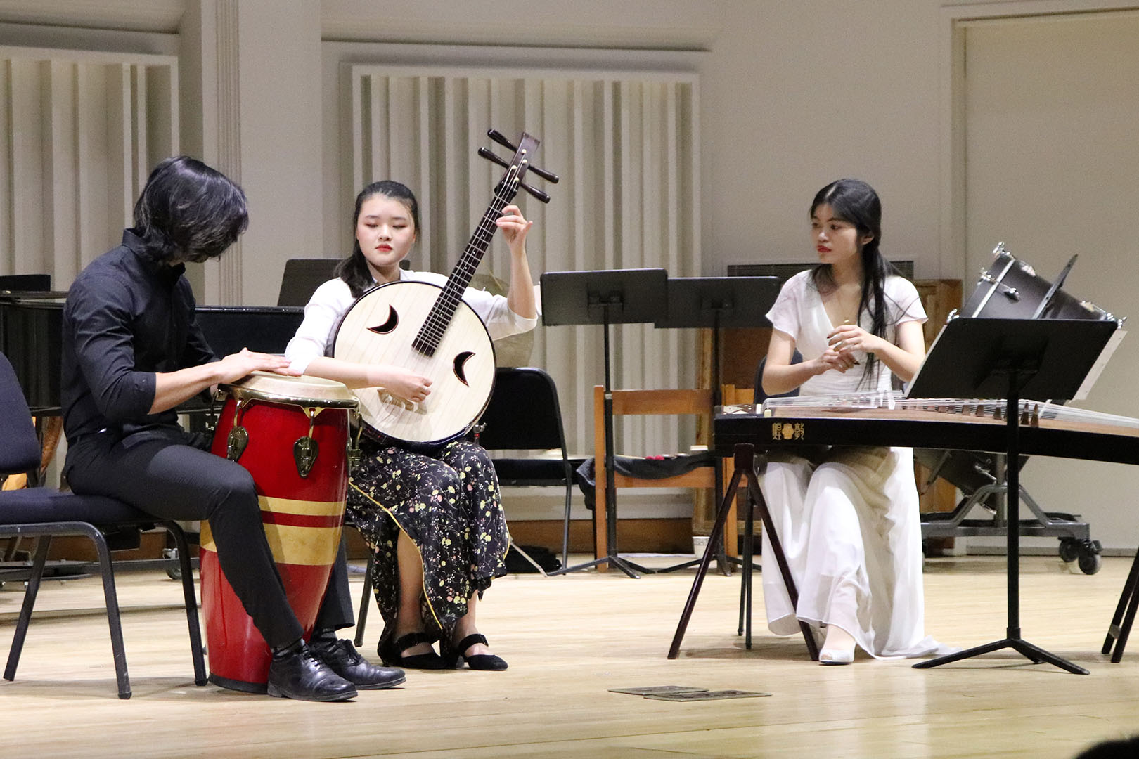 "Sibei Wang, Yuling Nan, and Arnav Shirodkar perform ""The Silk Road Camel"" (丝路驼铃) by Yong Ning. Photos by Sonita Alizada '23"
