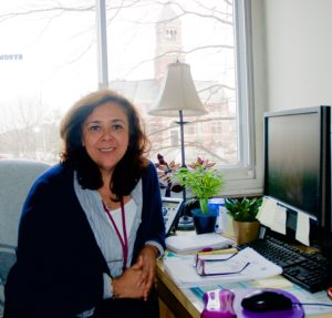 <em>Tatiana Rojas at her Kingston High School main office. Photo by Antonio Flores-Lobos.</em>